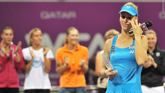 Elena Dementieva annouces her retirement on court in Doha, watched by fellow players.