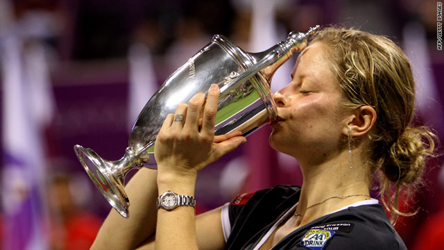 Kim Clijsters kisses her trophy after winning the WTA Championship title by defeating Caroline Wozniacki.