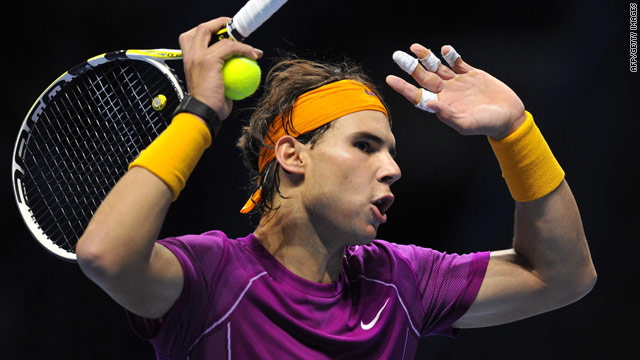 Rafael Nadal lost his cool over a disputed umpiring decision before going on to reach the last four in London.
