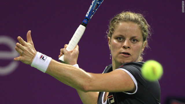 Kim Clijsters edged out Belgian rival Justine Henin in a special exhibition in Antwerp.