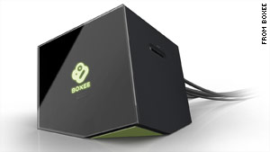 The Boxee Brown, a cube-like device that shares Internet content with your TV, is scheduled to go on sale this spring.
