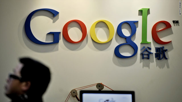 A man walks past the Google Chinese logo at the company's office in Shanghai, China, on Wednesday.