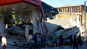 A gas station is destroyed in Jacmel, Haiti after the foundation of a house fell on it Wednesday.