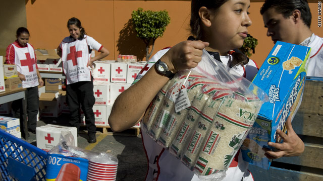 Members of the Mexican Red Cross collect supplies for Haiti on Thursday.