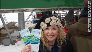 Blogger Amber Johnson shows off tickets to watch her son's namesake, skier Bode Miller, compete.