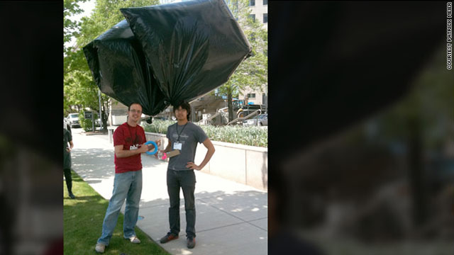 Jeffrey Warren, right, and Patrick Meier test their idea for making trash bag weather balloons that shoot aerial photos.