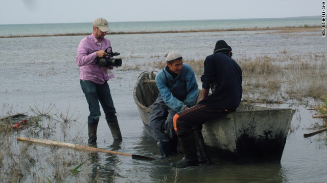 CNN's Neil Bennett films Kazak fishermen at work on the shores of the Aral Sea.