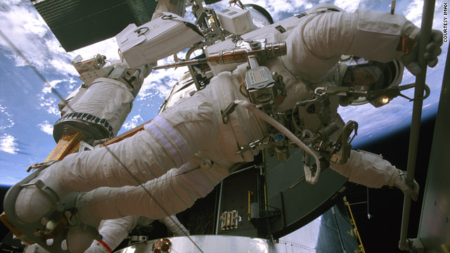 "Astronaut Andrew Feustel moves equipment that will be used to fix the Hubble telescope in a scene from ""Hubble 3D."""
