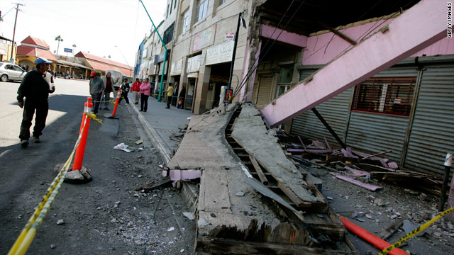 Residents survey the damage to a building after a magnitude 7.2 earthquake Monday in Mexicali, Mexico.