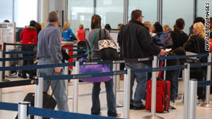 Travelers stand in line at Chicago's O'Hare airport on December 26.