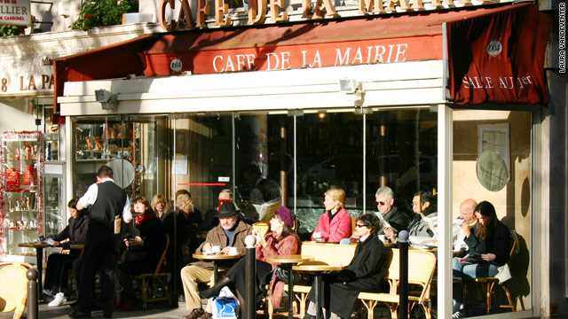 No matter the weather, many Parisians sip their coffee outside.