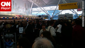 An iReport photo shows crowds at New York's John F. Kennedy airport.