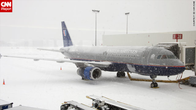 Winter weather hits Port Columbus International Airport in Columbus, Ohio, on Tuesday in a photo from iReporter Ed Kavishe.