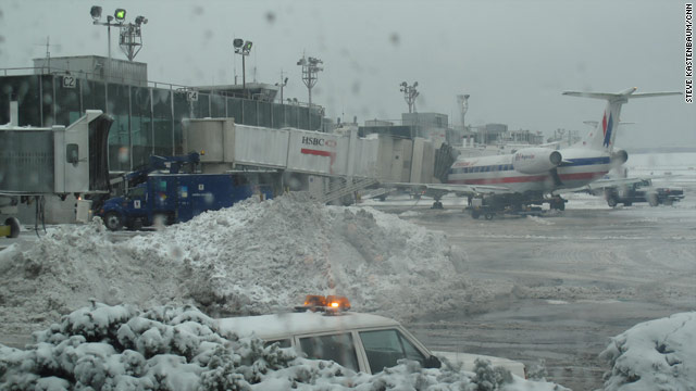 Snow has snarled operations at New York's LaGuardia Airport. Most airlines canceled most flights in and out of the airport.