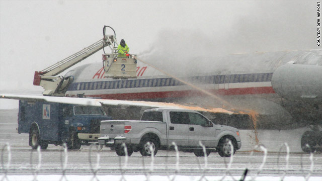 A crew de-ices a plane Thursday at Dallas/Fort Worth International Airport in Texas.