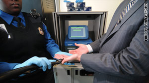 A TSA officer demonstrates swabbing at Washington's Reagan National Airport.