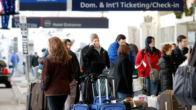 Passengers arrive to check in at Detroit Metropolitan Airport, which topped the satisfaction study.