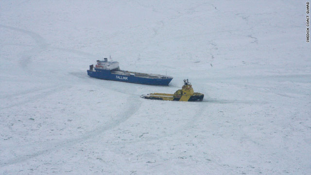 An icebreaker attempts to help a ship stuck in the Baltic Sea off Sweden