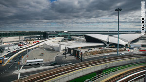 A runway overhaul and new rule on tarmac delays at John F. Kennedy International Airport are part of an air traffic debate.