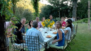 Friends and family gather for a meal at Bramasole, Frances Mayes' house in Tuscany.