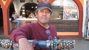 """Please tell them, the Americans, it's safe to come here,"" said Tijuana street vendor Juan Ramon Rocha."