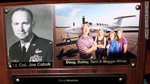 A plaque shows the White family next to an image of the pilot who died shortly after takeoff.