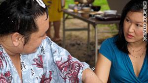 CNN correspondent Kyung Lah interviews a sumo wrestler.