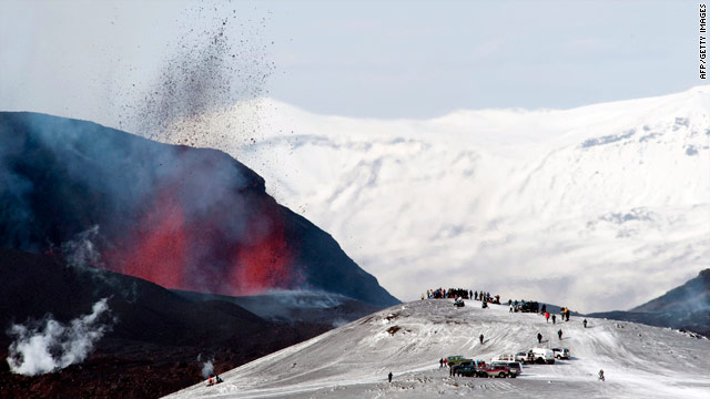 Tourists gather to watch lava spurt out of the site of a volcanic eruption at the Fimmvorduhals volcano near the Eyjafjallajokull glacier on March 27.
