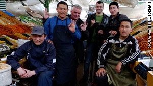 CNN's Ben Wedeman, third from left, makes new friends while on assignment this week in Bishkek, Kyrgyzstan.