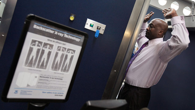 A TSA volunteer demonstrates a full-body scanner at Chicago's O'Hare International Airport last month.