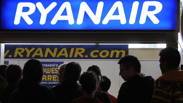 People queue up at a Ryanair office at Barajas airport on April 20 in Madrid.