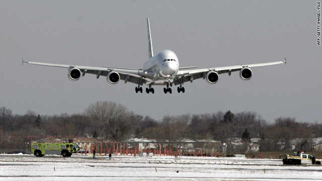 A plane lands at John F. Kennedy International Airport, where a key runway is closed for construction.