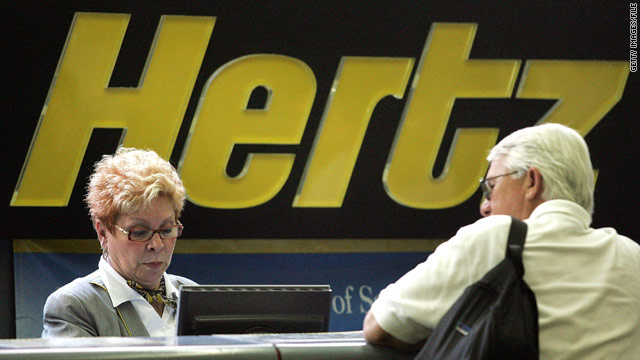 A Hertz worker helps a customer at its rental-car pickup area at Chicago's O'Hare International Airport.