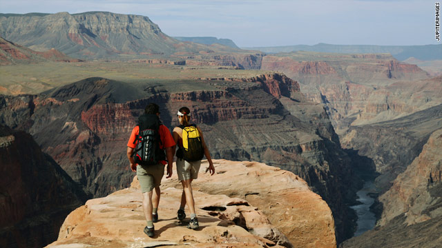 Visitors explore the Grand Canyon in Arizona. Tourism is a multi-billion dollar industry in the state.