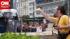 Protesters confront police last week near Greece's parliament building in Athens.
