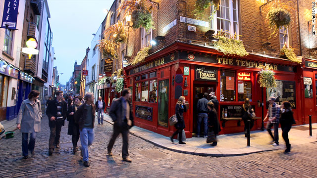 Pedestrians pass by Dublin, Ireland's Temple Bar. Ireland is stepping up efforts to attract visitors.