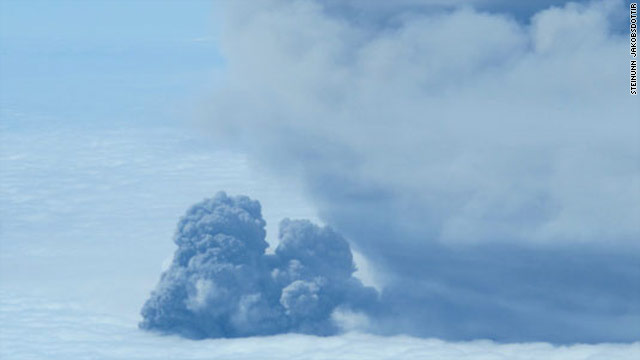 A picture taken by an Icelandic test flight over the volcano on Saturday 22nd May shows less ash and more steam being ejected.