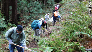 Volunteers clear a trail during a Sierra Club service trip.