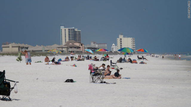 Tourists enjoy Pensacola Beach, Florida, last month. The region has seen a drop in vacation bookings.
