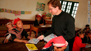 Christopher Hill, founder and managing director of Hands Up Holidays, teaching English to the Hmong community in Sapa, Vietnam.