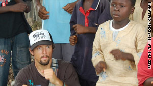 Jason Mraz with Maxwell, one of the children he met during his trip to Ghana.