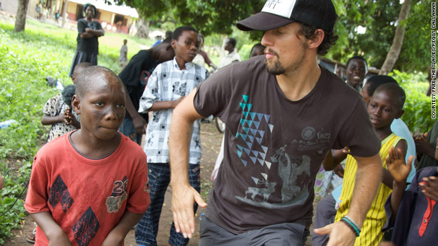 Jason Mraz shows off some dance moves with Abeiku, one of the children he met during his trip to Ghana.