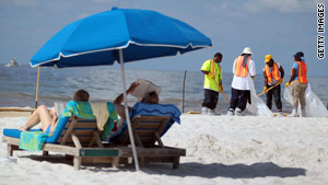 Workers clean up oil residue earlier this week on Orange Beach, Alabama.
