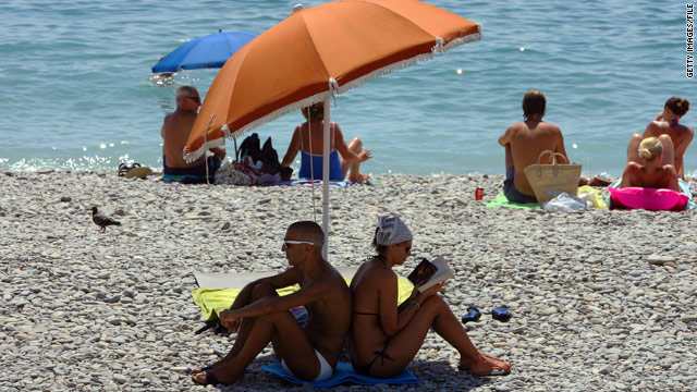 Sunbathers enjoy a beach in the south of France. It's not unusual to see Europeans opt out of bathing suits.