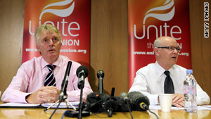 Brian Boyd and Brendan Gold, the Unite union's officers for civil aviation, annouce result of vote to go on strike.