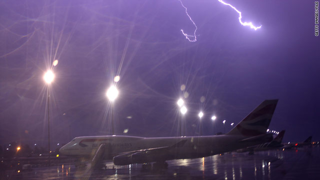 Lightning strikes over a plane at Johannesburg International airport in Johannesburg, South Africa, last year.