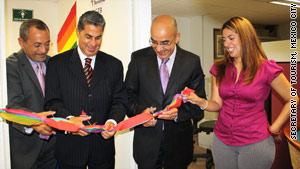 Mexico City officials cut a rainbow ribbon to open the city's new gay tourism office.