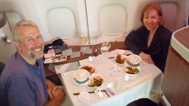 Jake and Linda Richter enjoy fine dining in first class on a flight from California to China.
