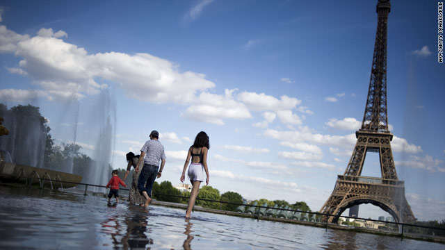 Tourists stroll through Trocadero Square recently near the Eiffel Tower in Paris, France.