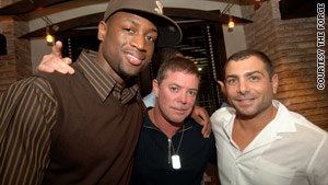 Dwyane Wade with Shareef Malnik, owner of The Forge, center, and  Antonio Misuraca, right.